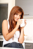 Young woman with a cup of coffee Stock Images
