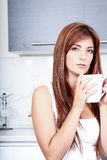 Young woman with a cup of coffee Stock Photography