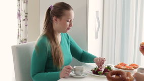 Young woman with a cup of coffee. Breakfast at the girl. Women drinking coffee at breakfast. stock video footage