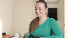 Young woman with a cup of coffee. Breakfast at the girl. Women drinking coffee at breakfast. stock video