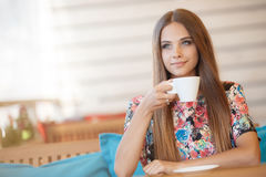 A young woman with a Cup of coffee in a cafe Royalty Free Stock Photography