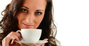 Young woman with cup of coffee isolated on white Stock Photography