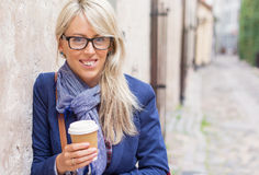 Young woman with cup of coffee outdoors. Stock Image