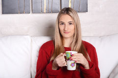 Young woman with a cup of coffee. Royalty Free Stock Photo