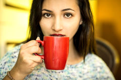Young woman with a cup of coffee Royalty Free Stock Image