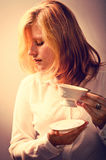 Young woman with a cup of coffee - retouching Vintage Stock Photo