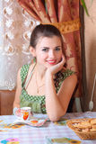 young woman with a cup of cofree at home Royalty Free Stock Image