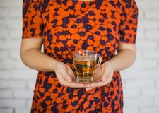 Young woman with cup of green tea in her hands Royalty Free Stock Photo