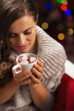 Young woman with cup of hot chocolate with marshmallow Stock Photos