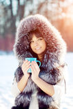Young woman with a cup of hot drink Winter woman on background o Stock Image