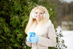Young woman with a cup of hot drink Royalty Free Stock Photo