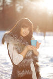 Young woman with a cup of hot drink Stock Image