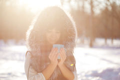 Young woman with a cup of hot drink Stock Photography