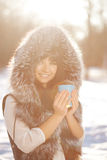 Young woman with a cup of hot drink Stock Photos