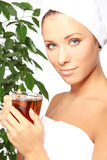 Young woman with cup of hot tea Stock Photos