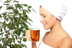 Young woman with cup of hot tea Stock Image