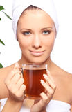 Young woman with cup of hot tea Stock Photography