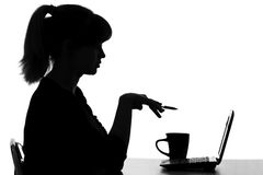 Young woman with a cup on a table int he Internet Stock Photography