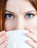 Young woman with cup of tea Royalty Free Stock Images