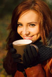 Young woman with cup of tea Stock Photography