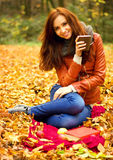 Young woman with cup of tea Royalty Free Stock Photos