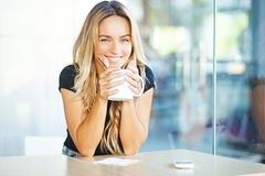 Young woman with cup of tea Royalty Free Stock Photography