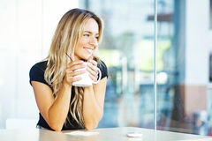 Young woman with cup of tea Stock Images
