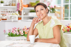 Young woman with cup of tea Stock Photo