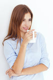 Young woman with cup of tea or coffee Royalty Free Stock Images