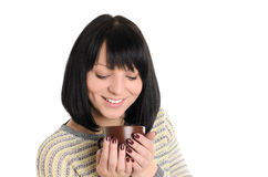 Young woman with cup of tea or coffee in hands Royalty Free Stock Image