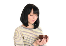 Young woman with cup of tea or coffee in hands Stock Photo