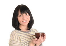 Young woman with cup of tea or coffee in hands Royalty Free Stock Images