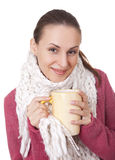 Young woman with cup in winter sweater and scarf Royalty Free Stock Photography