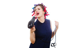 Young woman in curler expressively singing. . Photo of young singing woman Royalty Free Stock Photos
