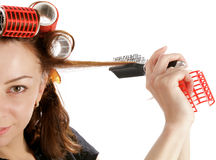 Young Woman in Curlers Royalty Free Stock Image