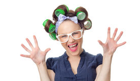 Young woman with curlers. Funny woman with curlers. Funny girl isolated on white background, studio-shot stock photos