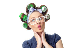 Young woman with curlers Stock Photography