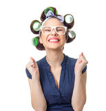 Young woman with curlers. Joyous woman with curlers. Funny girl isolated on white background, studio-shot stock photo