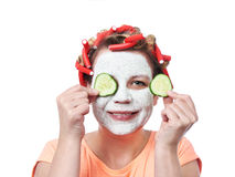 Young woman in curlers and with a mask on her face Stock Photos