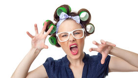 Young woman with curlers. Offensive woman with curlers. Feisty girl isolated on white background, studio-shot Stock Photo