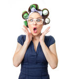 Young woman with curlers. Scared woman with curlers. Funny girl isolated on white background, studio-shot Stock Images