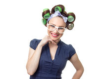 Young woman with curlers. Smiling happy woman with curlers. Funny girl isolated on white background, studio-shot Stock Images