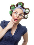 Young woman with curlers Royalty Free Stock Photography