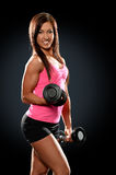 Young Woman Curling Dumbbells Royalty Free Stock Photos