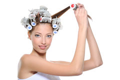 Young woman curling her hair Stock Photo