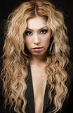 Young woman with curly blonde hair Royalty Free Stock Photo