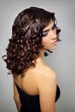 Young woman with curly hair stock image