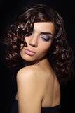 Young woman with curly hair Stock Images
