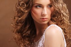 Young woman with curly hair Stock Photos
