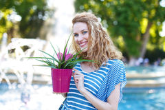 Young woman with curly hair with bromelia Royalty Free Stock Photography